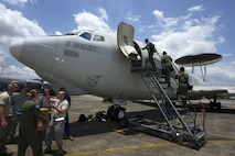 Airmen from the 961st Airborne Air Control Squadron and Aircraft Maintenance Unit discuss preflight information while Philippine Air Force (PAF) air battle managers board a 961st AACS E-3 Sentry AWACS during exercise Balikatan 2015 on Clark Air Base, Philippines, April 23, 2015. This exercise marks the first time in history that PAF air battle managers have controlled other aircraft while on board the AWACS. Since the exercise began April 20, 2015, the 961st AACS has integrated 20 PAF weapons controllers during their missions to provide them with firsthand experience using the aircraft's systems. The 961st AACS is stationed at Kadena Air Base, Japan. (U.S. Air Force photo/Staff Sgt. Maeson L. Elleman)