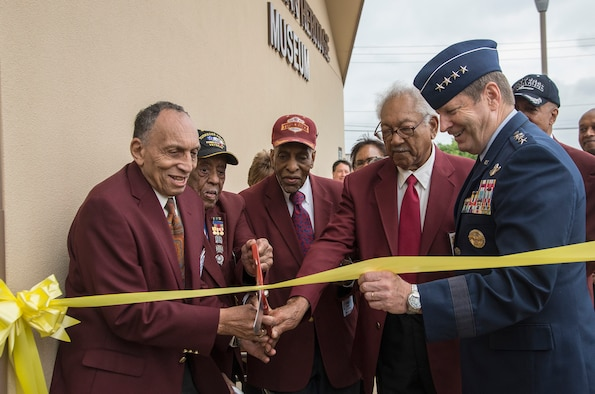 Tuskegee Airmen (from left) Eugene Derricotte, Thomas M. Ellis, Granville C. Coggs and James L. Bynum and the commander of Air Education and Training Command, Gen. Robin Rand, cut the ribbon May 4, 2015, at Joint Base San Antonio-Lackland's Airman Heritage Museum. The unveiling ceremony honors the enlisted Tuskegee Airmen, a group of African-American military ground support Airmen who were part of the 332nd Fighter Group and the 477th Bombardment Group during World War II. (U.S. Air Force photo/Johnny Saldivar)