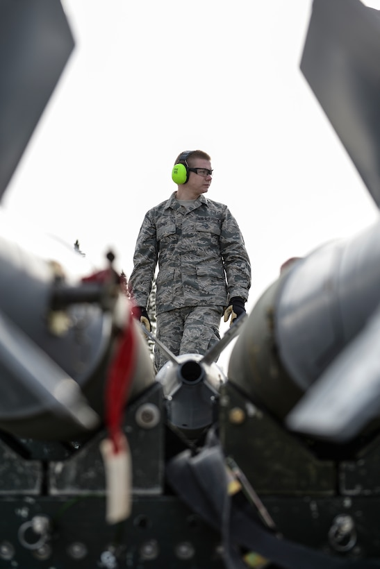 Senior Airman Keith Brandt, a munitions systems journeyman assigned to the 180th Maintenance Squadron, loads MK-82 general purpose bombs onto a trailer May 1, 2015, during Red Flag-Alaska 15-2 at Eielson Air Force Base, Alaska. The exercise enables units from around the globe to conduct live-fire training, utilizing 67,000 square miles of airspace over the Joint Pacific Alaska Range Complex. (U.S. Air Force photo/Senior Airman Peter Reft)