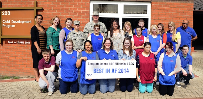 Members of the 100th Force Support Squadron Child Development Program gather for a group photo with Col. Kenneth T. Bibb, Jr., the 100th Air Refueling Wing commander and Chief Master Sgt. Kathryn Aleshire, the 100 ARW acting command chief, April 13, 2015, at the child development center on Royal Air Force Mildenhall, England. The CDC team was recently chosen as the Air Force's best Child Development Program of the Year 2014. (U.S. Air Force photo/Staff Sgt. Krystie Martinez)