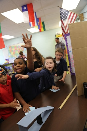 Children brief other classmates and teachers on their STEMposium projects at Charles F. Bolden Elementary School on Laurel Bay housing in Beaufort, S.C., May 1, 2015.  Students collaborate in a real-world, problem-solving challenge requiring them to draw on a multitude of STEM-based resources. This year marks the third annual STEMposium fair. (U.S. Marine Corps photo by Lance Cpl. Olivia G. Ortiz/Released)