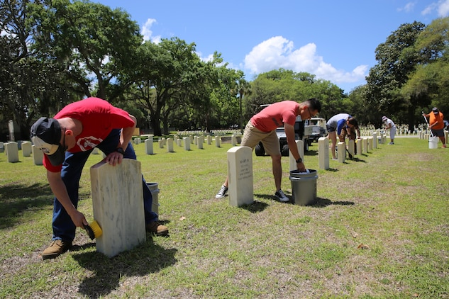 Beaufort community service members, veterans and civilians lent a helping hand and helped clean the Beaufort National Cemetery, May 5. The cleanup event is held annually to get the cemetery ready for Memorial Day ceremonies held on May 25. Volunteers planted new grass, cleaned and weeded mulch beds, and scrubbed as many of the 21,000 pearl white headstones that cover the cemetery grounds as possible.