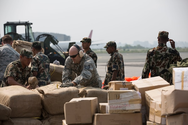 KATHMANDU, Nepal (May 7, 2015) - U.S. Airmen and Nepalese service members dismount a pallet of humanitarian aid after an aircraft offload during Joint Task Force 505 humanitarian assistance and disaster relief at Tribhuvan International Airport. The Nepalese government requested the U.S. government's assistance after a 7.8 magnitude earthquake struck the country April 25. U.S Marines from III Marine Expeditionary Force came together with other services to provide unique capabilities to assist Nepal.