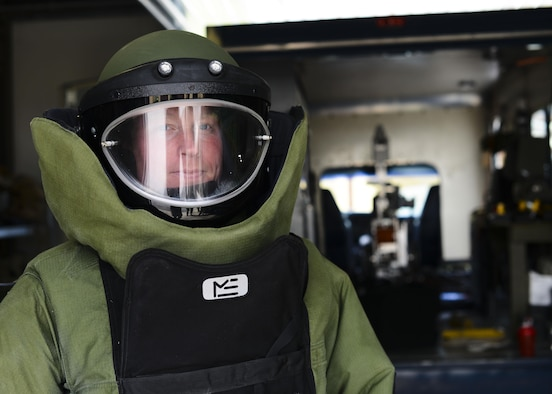 Tech. Sgt. Lawrence Miller, the 31st Civil Engineer Squadron explosive ordnance disposal training NCO in charge, dons an EOD 9 Bomb Suit April 22, 2015, at Aviano Air Base, Italy. The suit consists of numerous layers of Kevlar, plastic and foam that protect the wearer's organs and prevent any spinal damage from the force of the blast. (U.S. Air Force photo/Senior Airman Austin Harvill)