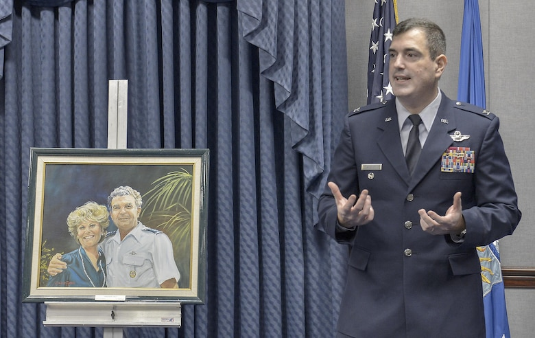 Col. Mark August speaks the audience in the Pentagon during the 2014 General and Mrs. Jerome F. O'Malley Award ceremony May 8, 2015, in Washington. Air Force Chief of Staff Gen. Mark A. Welsh III presented Col. and Mrs. August with the award recognizing a wing commander and spouse team whose contributions to the nation, Air Force, and local community best exemplified the highest ideals and positive leadership of a military couple in a key Air Force position. Col. and Mrs. August received the award for their time as the commander and spouse at the 374th Airlift Wing, Yokota Air Base, Japan.  (U.S. Air Force Photo/Michael J. Pausic)