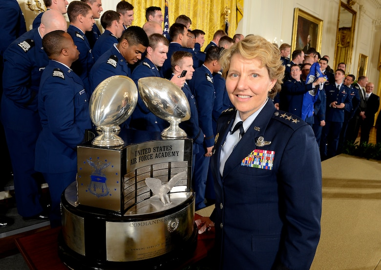 Lt. Gen. Michelle D. Johnson, the superintendent of the U.S. Air Force Academy, in Colorado Springs, Colo., stands with the Commander-in-Chief's Trophy with some of the Academy football team behind her, at the White House May 7, 2015. President Barack Obama congratulated the team, with Johnson and Air Force Chief of Staff Gen. Mark A. Welsh III present for a ceremony. (U.S. Air Force photo/Scott M. Ash)