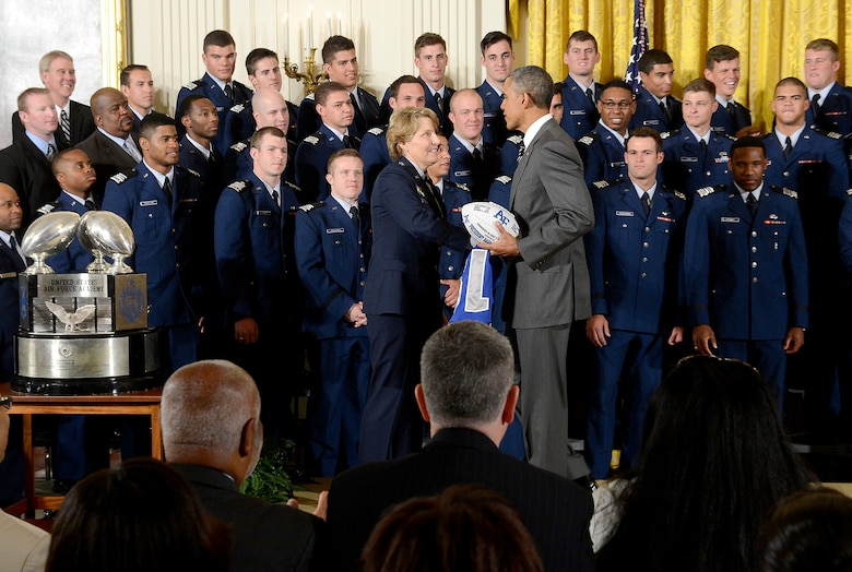 President Barack Obama congratulates Lt. Gen. Michelle D. Johnson, the superintendent of the U.S. Air Force Academy, after he presented the Academy football team with the Commander-in-Chief's Trophy at the White House May 7, 2015. (U.S. Air Force photo/Scott M. Ash)