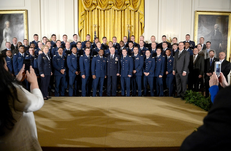 Air Force Chief of Staff Gen. Mark A. Welsh III, center, stands with Lt. Gen. Michelle D. Johnson, superintendent of the U.S. Air Force Academy, and Academy head football coach Troy Calhoun, after the team received the Commander-in-Chief's trophy from President Barack Obama at the White House May, 7, 2015. (U.S. Air Force photo/Scott M. Ash)
