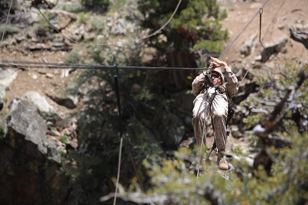 Cpl. Jordan Yearsley, combat engineer, Engineer Platoon, Headquarters and Service Company, Ground Combat Element Integrated Task Force, crosses a gorge on a rope during a Marine Corps Operational Test and Evaluation Activity assessment aboard Marine Corps Mountain Warfare Training Center Bridgeport, California, May 5, 2015. From October 2014 to July 2015, the GCEITF will conduct individual and collective level skills training in designated ground combat arms occupational specialties in order to facilitate the standards-based assessment of the physical performance of Marines in a simulated operating environment performing specific ground combat arms tasks. (U.S. Marine Corps photo by Cpl. Paul S. Martinez/Released)