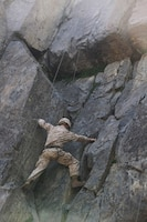 Cpl. Destin L. Ridge, rifleman, Alpha Company, Ground Combat Element Integrated Task Force, climbs a 40-foot cliff face during a pilot Marine Corps Operational Test and Evaluation Activity assessment aboard Marine Corps Mountain Warfare Training Center Bridgeport, California, May 5, 2015. From October 2014 to July 2015, the GCEITF will conduct individual and collective level skills training in designated ground combat arms occupational specialties in order to facilitate the standards-based assessment of the physical performance of Marines in a simulated operating environment performing specific ground combat arms tasks. (U.S. Marine Corps photo by Cpl. Paul S. Martinez/Released)