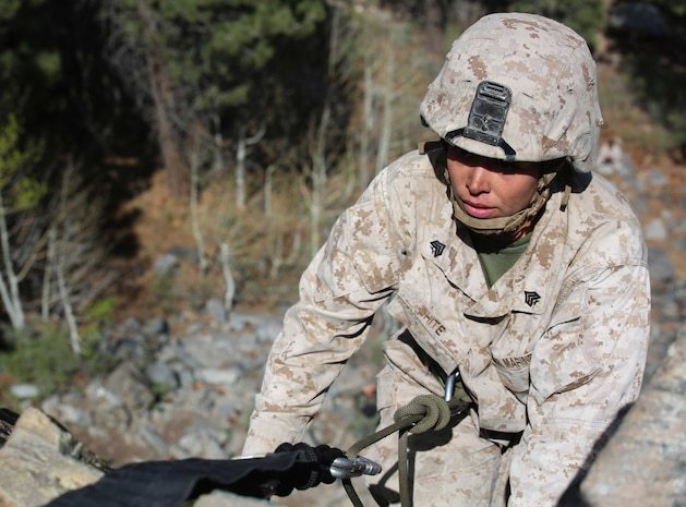Sgt. Courtney G. White, machine gunner, Weapons Company, Ground Combat Element Integrated Task Force, prepares to descend a 40-foot cliff face during a pilot Marine Corps Operational Test and Evaluation Activity assessment aboard Marine Corps Mountain Warfare Training Center Bridgeport, California, May 5, 2015. From October 2014 to July 2015, the GCEITF will conduct individual and collective level skills training in designated ground combat arms occupational specialties in order to facilitate the standards-based assessment of the physical performance of Marines in a simulated operating environment performing specific ground combat arms tasks. (U.S. Marine Corps photo by Cpl. Paul S. Martinez/Released)
