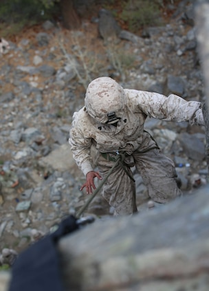 Sgt. Courtney G. White, machine gunner, Weapons Company, Ground Combat Element Integrated Task Force, descends a 40-foot cliff face during a pilot Marine Corps Operational Test and Evaluation Activity assessment aboard Marine Corps Mountain Warfare Training Center Bridgeport, California, May 5, 2015. From October 2014 to July 2015, the GCEITF will conduct individual and collective level skills training in designated ground combat arms occupational specialties in order to facilitate the standards-based assessment of the physical performance of Marines in a simulated operating environment performing specific ground combat arms tasks. (U.S. Marine Corps photo by Cpl. Paul S. Martinez/Released)