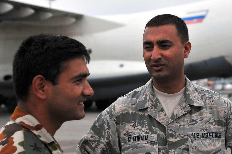 U.S. Air Force Senior Airman Manoj Khatiwada (right), 21st Medical Operations Squadron aerospace medical technician, talks with a Nepalese Army soldier, Tribhuvan International Airport in Kathmandu, Nepal, May 7, 2015. Manoj joined a team from the 36th Contingency Response Group to assist U.S. Air Force, U.S. Department of State and U.S. Agency for International Development operations by assisting with communicating with the Nepalese Army as they process relief supplies following a magnitude 7.8 earthquake that struck the region April 25, 2015. (U.S. Air Force photo by Staff Sgt. Melissa White/Released)