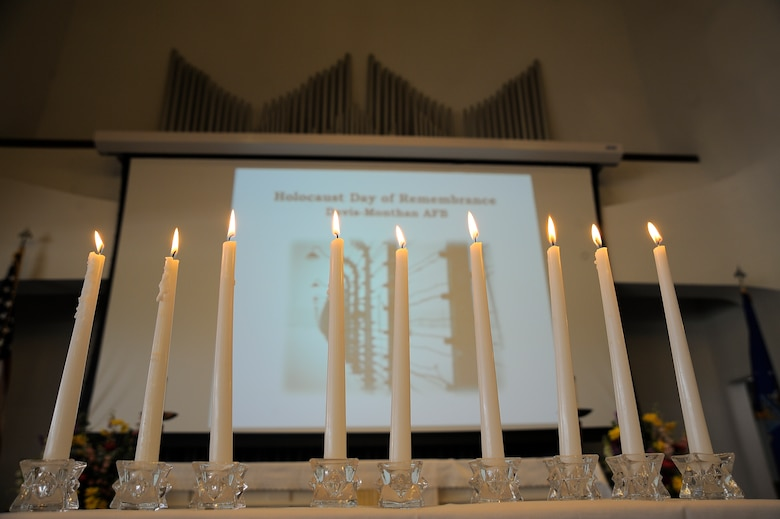 Nine candles burn for the Holocaust Day of Remembrance at Davis-Monthan Air Force Base, Ariz., May 7, 2015. The first 6 candles were lit to honor the 6 million Jewish Holocaust victims. The 7th was lit to remember the remaining millions of non-Jewish victims of the Nazis. The remaining two candles symbolized appreciation to symbolize to the members of the U.S. Armed Forces and the Allied forces for their role in liberating the victims of the Holocaust. (U.S. Air Force photo by Staff Sgt. Angela Ruiz/Released)