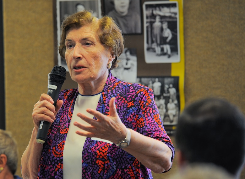 Yulia Genina, Holocaust survivor, shares her story of survival with an audience during the Holocaust Day of Remembrance at Davis-Monthan Air Force Base, Ariz., May 7, 2015. Genina shared the story of when her family was forced from their home when she was a young girl.