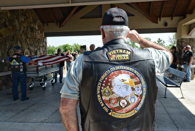 Members of the Patriot Guard Riders salute and show their respects during a flag folding ceremony at the Fort Sill National Cemetery May 4. (Air Force photo by Kelly White/Released)
