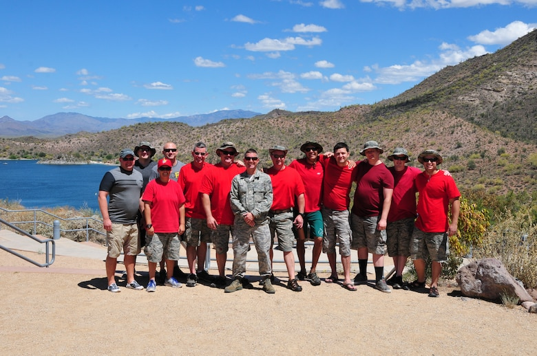 Col. Chris Triebel (left), 161st Air Refueling Wing vice commander, poses with the Aircrew Flight Equipment shop for a group photo after completing water survival training May 3, 2015, at Lake Pleasant, Peoria, Ariz. AFE is responsible for teaching the aircrew's water survival refresher training every three years. (U.S. Air National Guard photo by Master Sgt. Kelly M. Deitloff)
