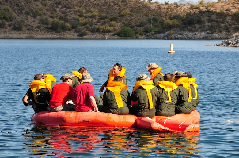 Airmen from the 161st Air Refueling Wing take accountability of personnel on a 20 man life raft during water survival training at Lake Pleasant, Peoria, Ariz., May 3, 2015.  Water survival training encompasses equipment familiarization and processes in the event of an emergency over-water ditching scenario.    (U.S. Air National Guard photo by Master Sgt. Kelly M. Deitloff)
