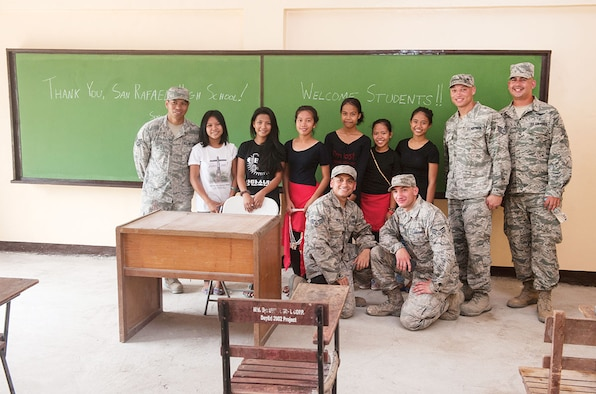 U.S. Air Force airmen, from the 673rd Civil Engineer Group, pose for a photo with residents of barangay San Rafael, in a newly built classroom during exercise Balikatan 2015's San Rafael Elementary School ribbon cutting, in San Rafael, Palawan, Philippines, April 28. Construction of the BK15 humanitarian civic assistance projects started this past March with the Armed Forces of the Philippines, U.S. forces and Australian forces working shoulder-to-shoulder to construct a two-classroom building for Santa Lourdes National High School, Sabang Elementary School, San Rafael High School and San Rafael Elementary School. This year marks the 31st iteration of the exercise, which is an annual Philippine-U.S. bilateral military training exercise and humanitarian civic assistance engagement. (U.S. Air Force photo by Staff Sgt. Christopher Hubenthal/Released)