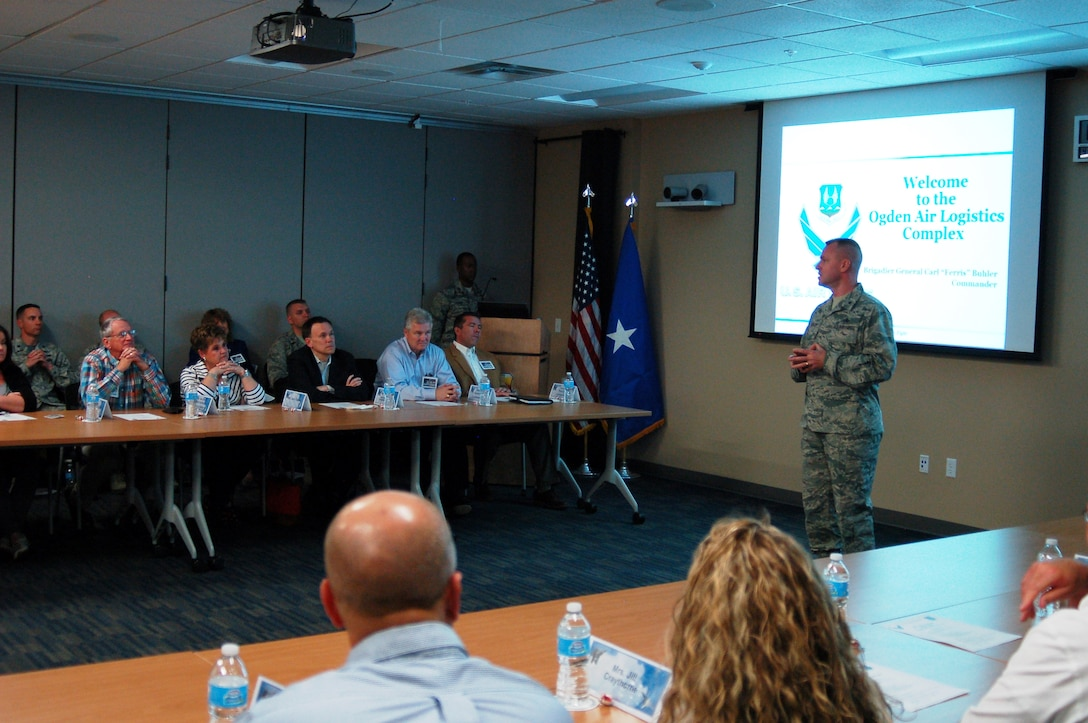 "Brig. Gen. Carl Buhler, Ogden Air Logistics Complex commander, speaks to a group of 24 visitors, including state, local and federal leaders, who learned about the ALC's ""Road to 30 Percent Depot Flow Day Reduction."" (U.S. Air Force photo)"