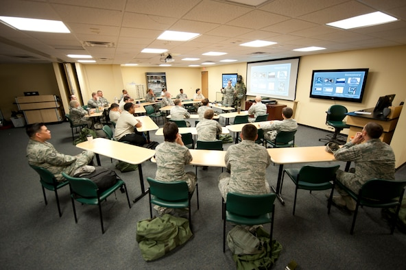 Airmen participate in a chemical, biological, radiological and nuclear defense survival skills training course on Nellis Air Force Base, Nev., April 30, 2015. The CBRN defense course consists of individual knowledge-based and demonstration performance objectives that provide an in-depth education on CBRN defense hazards and protective actions. (U.S. Air Force photo by Airman 1st Class Mikaley Towle)