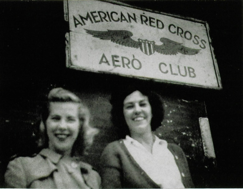 The American Red Cross (ARC) had a field office deployed with the 371st Fighter Group that stayed with the group all the way from Normandy to Bavaria, enduring the same field conditions as group members did.  Here two members of the ARC field office, Ms. Barbara Wright and Ms. Nancy Orr, stand outside the Aero Club, a recreational retreat for the 371st team.  The facility and offerings varied with the resources available at each of the locations the group moved to during its nomadic existence in Northwestern Europe.  Of note, Nancy Orr married 371st group member Capt. Rudolph L. Talbot in 1945 and they went on postwar to found the successful Talbots women's clothing store chain.  (The Story of the 371st Fighter Group in the E.T.O.)
