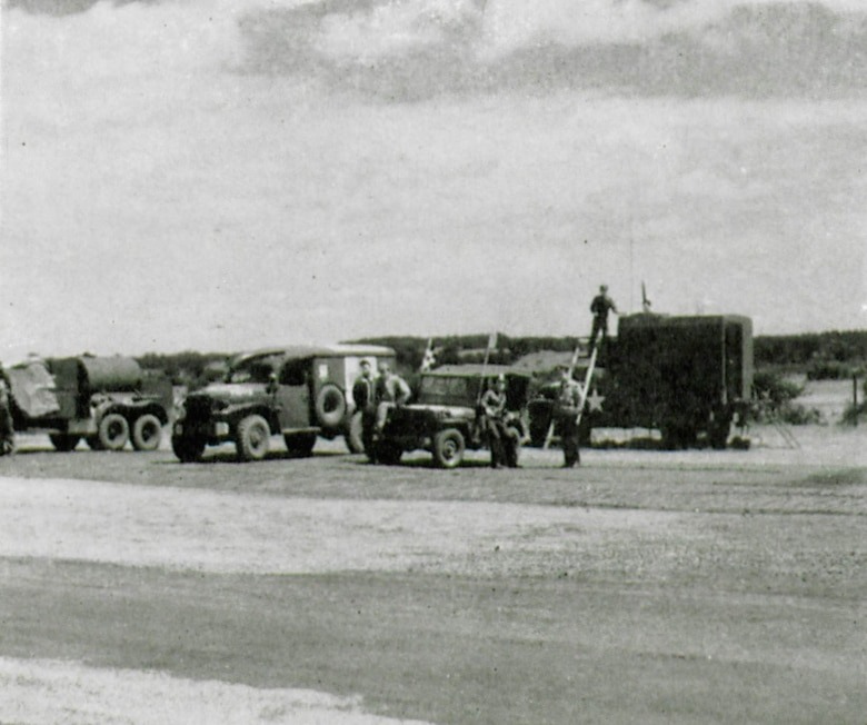 Ready on the flightline are representative vehicles from several of the units attached to the 371st Fighter Group during the war.  Present in the picture are vehicles of the Firefighters, Medics and Flying Control.  Motor transport and specialty vehicles were a great help to the conduct of expeditionary air operations.  (The Story of the 371st Fighter Group in the E.T.O.)