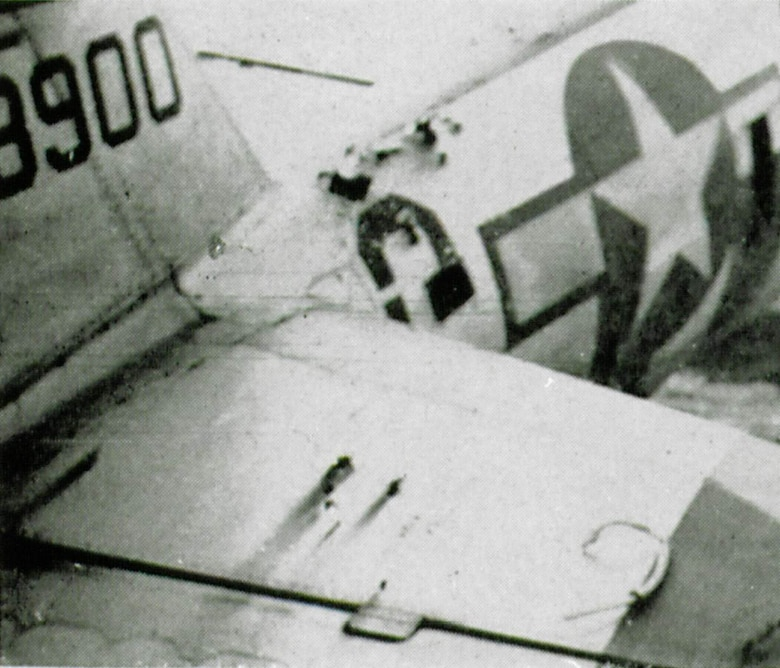 A 405th Fighter Squadron Thunderbolt, probably P-47D-28-RA serial number 42-28900, shows some battle damage from flak.  Although the holes atop the fuselage and horizontal stabilizer appear small, bullets or fragments of exploding shells could easily cause critical harm to the pilot or components inside the aircraft.  Repair of battle-damaged aircraft was an ongoing activity during the war in addition to the usual required maintenance.  (The Story of the 371st Fighter Group in the E.T.O.)