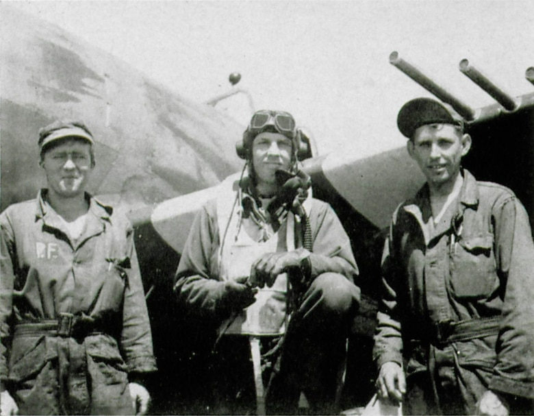 Group Commander Col. Bingham T. Kleine was the wartime commander of the 371st Fighter Group.  He is shown here in between two members of his ground crew, likely men from the 404th Fighter Squadron.  The initial P.F. on the overall on the man at left suggest possibly Sgt. Percy M. Freer of that squadron.  This picture may have been taken on D-Day, just prior to the group's first mission that day, with the famous black/white recognition stripes visible on the wing behind them.  (The Story of the 371st Fighter Group in the E.T.O.)
