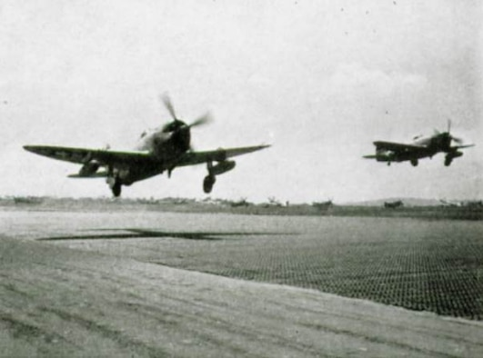 A pair of 371st Fighter Group P-47 Thunderbolt fighters on takeoff from an airfield in Europe.  The Republic P-47 Thunderbolt fighter was the primary aircraft assigned to the 371st Fighter Group during World War II.  The group operated both the Razorback and Bubbletop versions of the Thunderbolt, including those produced at Republics primary factory at Farmingdale, New York as well as its wartime factory at Evansville, Indiana.  (The Story of the 371st Fighter Group in the E.T.O.)