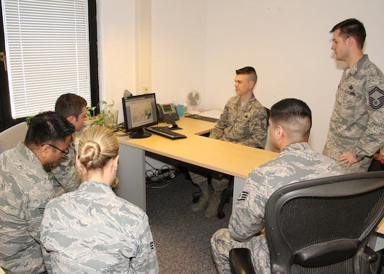 Senior Master Sgt. Nicholas Kollett, Enlisted Force Development Manager, Joint Force Headquarters, Massachusetts Air National Guard, Hanscom, Air Force Base, Mass., trains active-duty members on the Virtual Personnel Center (vPC) program, Ramstein Air Force Base, Germany, May 7, 2015. The active duty is currently using the Evaluation Management System (EMS) that is being phased out, requiring them to transition to vPC by September of this year. (U.S Air Force photo by Master Sgt. Kevin Martin/Released)