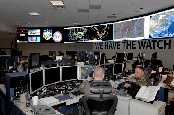 Members of U.S. Northern Command and the North American Aerospace Defense Command monitor systems and networks in the NORAD and Northcom Command Center on Peterson Air Force Base in Colorado Springs, Colorado, April 29, 2014. Courtesy photo by Mike Kucharek