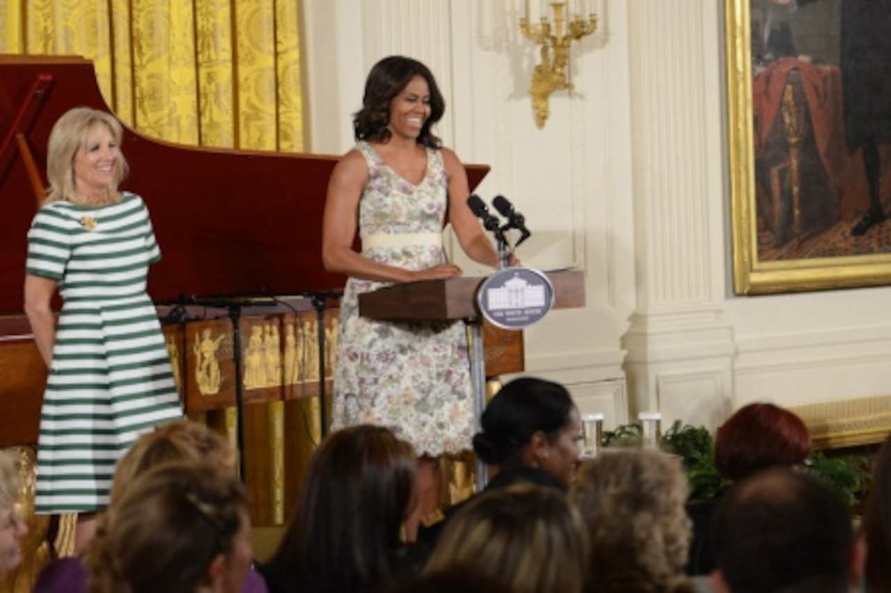 First Lady Michelle Obama, accompanied by Dr. Jill Biden, wife of Vice President Joe Biden, at left, speaks during a Mother's Day tea honoring military mothers, May 8, 2015. Military spouses and children, service members who are mothers, mothers with children in the military, and Gold Star mothers were among those who attended the event. Army News Service photo by Lisa Ferdinando