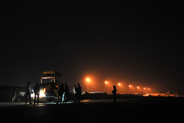 Civil Aviation Authority of Nepal members along with U.S. Air Force 36th Contingency Response Group Airmen attached to Joint Task Force-505 work together to repair the runway at the Tribhuvan International Airport in Kathmandu, Nepal, May 10, 2015. The Nepalese officials and Airmen teamed up to conduct necessary repairs to the airfield after it sustained damage following a magnitude 7.8 earthquake that struck the nation April 25, 2015. In response to the Nepal earthquake, the U.S. military sent Airmen, Marines, Soldiers and Sailors as part of JTF-505 to support the humanitarian assistance and disaster relief mission in Nepal at the direction of U.S. Agency for International Development. (U.S. Air Force photo by Staff Sgt. Melissa B. White/Released)