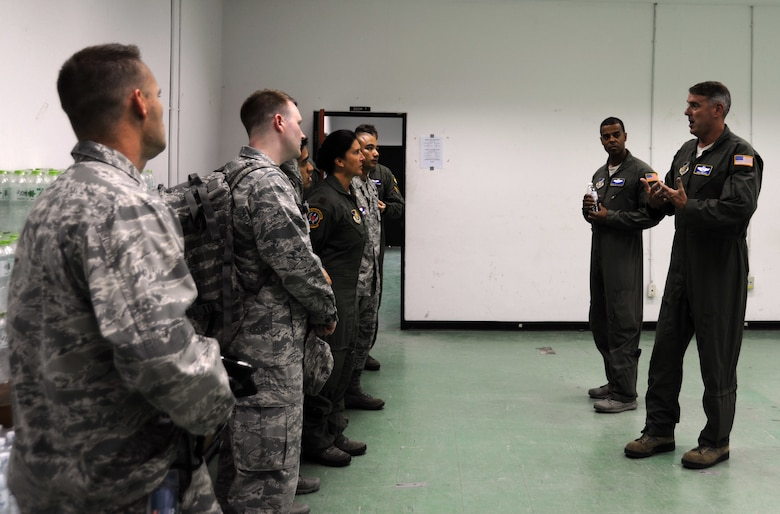 U.S. Air Force Brig. Gen. Michael Minihan, Joint Task Force-505 Joint Air Component Coordination Element commander, speaks with members of the 18th Aeromedical Evacuation Squadron as they join the JACCE team at Utapao Royal Thai Navy Airfield, Thailand, May 10, 2015. The joint operations center established in Utapao serves as a staging point for JTF-505 aviation assets and key planners conducting humanitarian aid and disaster relief operations in response to the 7.8 magnitude earthquake that struck Nepal, April 25, 2015. The 18th AES is deployed from Kadena Air Base, Japan. (U.S. Air Force photo by Staff Sgt. Alexander Martinez/Released)