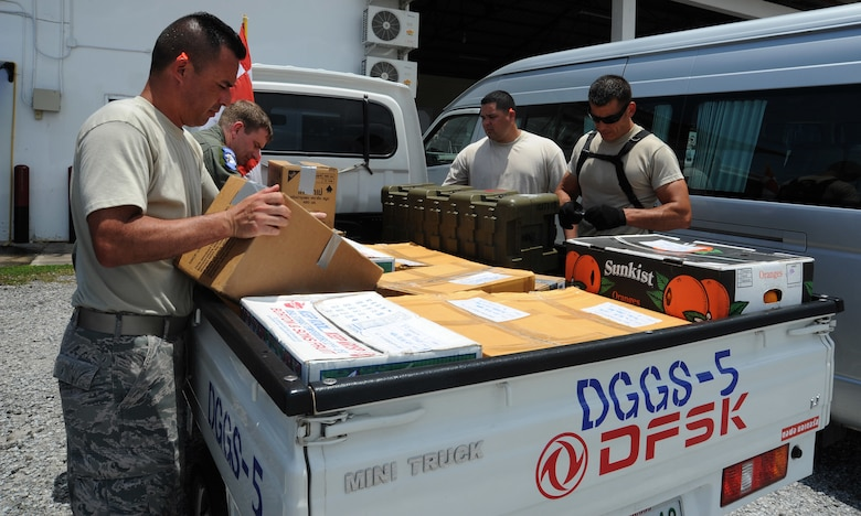 Joint Task Force-505 Airmen load the back of a truck with relief supplies bound for Kathmandu, Nepal in Utapao Royal Thai Navy Airfield, Thailand, May 10, 2015. The joint operations center established in Utapao serves as a staging point for JTF-505 aviation assets and key planners conducting humanitarian aid and disaster relief operations in response to the 7.8 magnitude earthquake that struck Nepal, April 25, 2015. (U.S. Air Force photo by Staff Sgt. Alexander Martinez/Released)