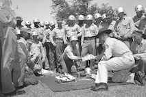 A drill instructor shows recruits different training items in this circa 1956 photo on Marine Corps Recruit Depot Parris Island, S.C. This gear was very similar to the kind they would use as Marines.