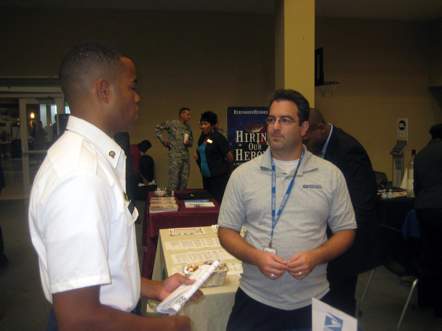 The National Guard Bureau recently hosted a jobs event for Guard spouses. In this photo, an Army Reserve Soldier speaking with a recruiter during the   Hire Our Heroes job fair the New York National Guard hosted at the Farmingdale Armed Forces Reserve Center on Wednesday, Aug. 14, 2013.