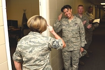 Maj. Gen. Stayce D. Harris, 22nd Air Force commander, returns the salute from Master Sgt. Spring Winters, 403rd Maintenance Group unit training manager, after giving her a 22nd AF commander's coin May 3, 2015, for receiving the military individual volunteer of the year recently at the 32nd Annual City of Biloxi, Miss. Volunteer Recognition ceremony. Harris visited the 403rd Wing at Keesler Air Force Base, Mississippi, May 1-4 to interact with the Citizen Airmen and gain a better understanding of the organization and the wing's mission. (U.S. Air Force photo/Tech. Sgt. Ryan Labadens)