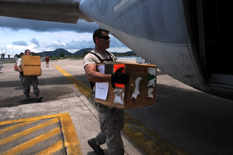 Tech. Sgt. Terrence Wright, an air transportation craftsman, loads a cooler containing units of blood bound for Kathmandu, Nepal, into a Marine Corps KC-130J Hercules at U-Tapao Royal Thai Navy Airfield, Thailand, May 10, 2015. A joint operations center established in U-Tapao serves as a staging point for JTF-505 aviation assets and key planners conducting humanitarian aid and disaster relief operations in response to the 7.8-magnitude earthquake that struck Nepal April 25. (U.S. Air Force photo/Staff Sgt. Alexander Martinez)