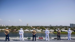 U.S. Marines and U.S. Navy Sailors with the 22nd Marine Expeditionary Unit and the amphibious assault ship USS Wasp man the rails of the Wasp as it leaves Port Everglades, Fla., May 10 at the conclusion of Fleet Week 2015. Marines and Sailors of the MEU, from Marine Corps Base Camp Lejeune, North Carolina, participated in Fleet Week Port Everglades May 4-10. The purpose of Fleet Week was to showcase the strength and capabilities of the Navy and Marine Corps team through tours, static displays and community relations events, and to provide the public the opportunity to meet and interact with Marines and Sailors.