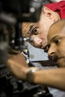 LtCol James Richardson and GySgt Joe Perera troubleshooting the Modular Advanced Armed Autonomous Robotic System (MAARS). MAARS is one of the unmanned systems the Marine Corps had on display at the expo.