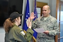 Col. James Dignan (right), 910th Airlift Wing commander, administers the oath of enlistment to 12-year-old Celina Dennis of Poland, Ohio, here, May 6, 2015. Dennis was selected as the 910th Airlift Wing's 61st Pilot for a Day, being sworn in as an honorary 2nd Lt. and treated to a day of military-themed activities here. Pilots for a Day are local children with chronic or life-threatening illnesses selected by Akron Children's Hospital Boardman campus. (U.S. Air Force photo/Eric M. White)