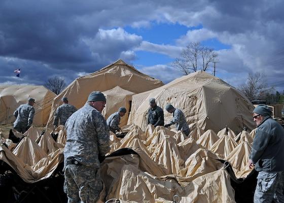 Deploying Indiana Guardsmen practice erecting new tent
