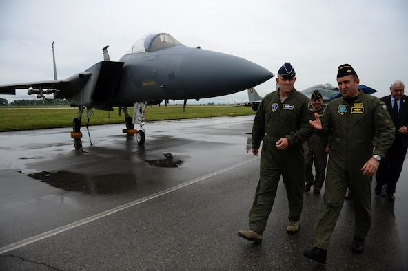 Gen. Frank Gorenc, the U.S. Air Forces in Europe and Air Forces Africa commander, walks with Maj. Gen. Rumen Radev, the Bulgarian Air Force commander, during a visit to Graf Ignatievo Air Base, Bulgaria, May 11, 2015. Airmen and F-15 Eagles from the 159th Expeditionary Fighter Squadron are part of Europe's first-ever theater security package deployment. The European TSP provides the opportunity for U.S. forces to train with NATO allies and is enabled by the strategic access provided by the infrastructure, support and host-nation relationships at U.S. and host-nation installations. (U.S. Air Force photo/Senior Airman Gustavo Castillo)