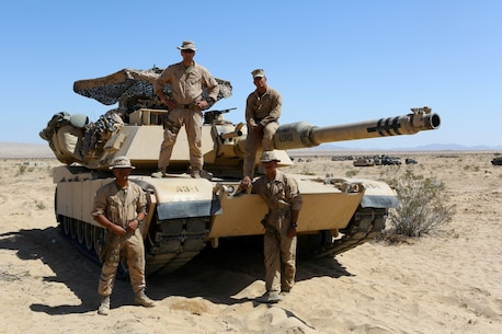 "Clockwise from top left, 1st Lieutenant John Neail, tank commander, Cpl. Christian Bills, gunner, Lance Cpl. Robert Benaridez driver, Lance Cpl. Patrick Bellinger, loader, the crew for the M1A1 Abrams Main Battle Tank named ""Star Lord"" participated in Desert Scimitar aboard Marine Corps Air Ground Combat Center Twentynine Palms, Calif. Desert Scimitar enables 1st Marine Division to test and refine its command and control capabilities and ensures 1st Marine Division units remain committed to consistently improving the quality of their training efforts and their resultant warfighting capabilities."