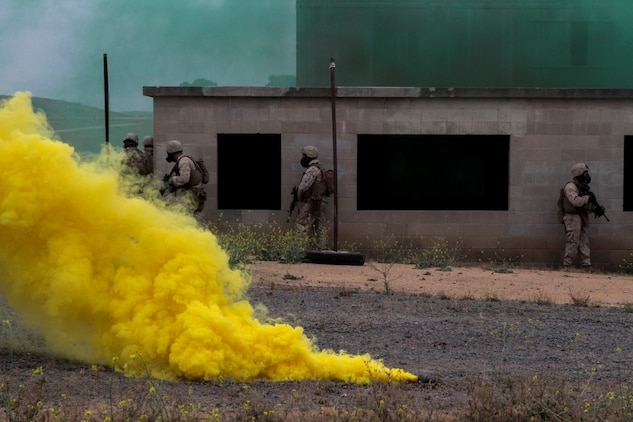 Marines with 1st Battalion, 7th Marine Regiment clear a building in a simulated combat town during the culminating event of Division School's Urban Leaders Course aboard Camp Pendleton, Calif., April 22, 2015. The three-week course is designed to prepare Marines to lead in an urban environment.