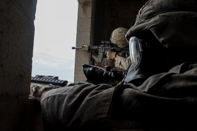Marines with 1st Battalion, 7th Marine Regiment provide security in a simulated combat town during the culminating event of Division School's Urban Leaders Course aboard Camp Pendleton, Calif., April 22, 2015. The three-week course is designed to prepare Marines to lead in an urban environment.