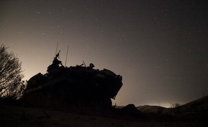 A Light Armored Vehicle (LAV-25) with 1st Light Armored Reconnaissance Detachment, Battalion Landing Team 3rd Battalion, 1st Marine Regiment, 15th Marine Expeditionary Unit, provides security for an amphibious raid during Certification Exercise (CERTEX) aboard Camp Pendleton, Calif., April 19, 2015. The Marines with the 1st LAR Det honed their skills as they prepare for their upcoming deployment. (U.S. Marine Corps photo by Cpl. Elize McKelvey/Released)