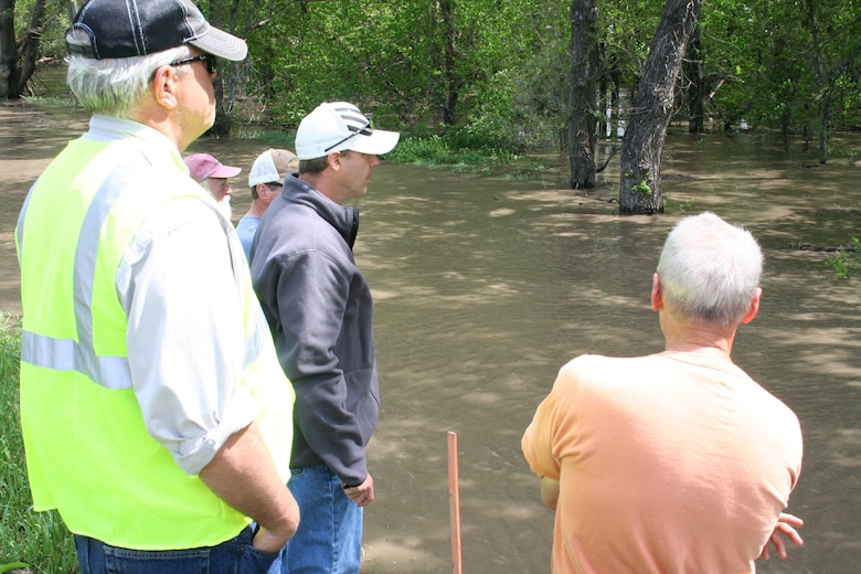 Teams from the Omaha District, U.S. Army Corps of Engineers and the Lower Platte South Natural Resources District evaluate an area on the land side of the Salt Creek levee in Lincoln. Bubbles are often an indication of a boil that is flowing water. After closer inspection, these bubbles were not from a boil.